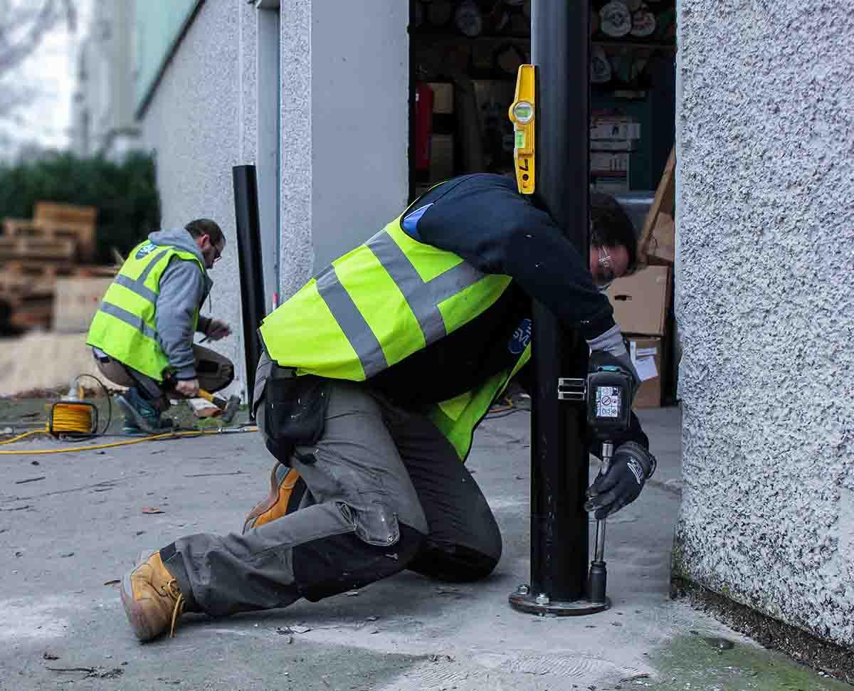 Installation service ireland, installers drilling in bollards